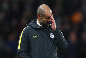 HULL, ENGLAND - DECEMBER 26:  Josep Guardiola, Manager of Manchester City reacts during the Premier League match between Hull City and Manchester City at KCOM Stadium on December 26, 2016 in Hull, England.  (Photo by Matthew Lewis/Getty Images)