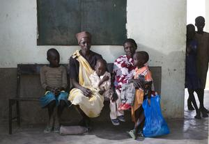 Mothers and their children at a health clinic at Aweng in Twic, South Sudan. Photo: Mark Condren