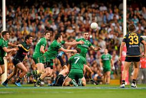 Sean Cavanagh moves to win possession for Ireland