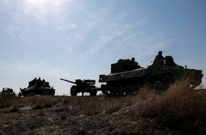 """Ukraine on Friday reported the first deaths in three days in east Ukraine, denting hopes a ceasefire will hold, and President Petro Poroshenko said Russia would pose a """"military threat"""" even if the truce is solid.  Reuters/Gleb Garanich"""