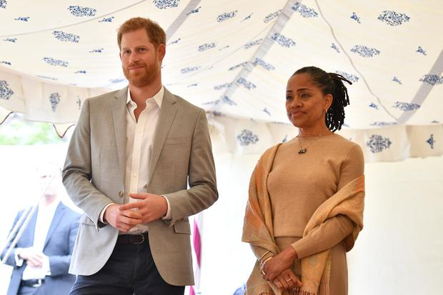 Britain's Prince Harry, and Doria Ragland listen to Meghan, Duchess of Sussex speaking at the launch of a cookbook with recipes from a group of women affected by the Grenfell Tower fire at Kensington Palace in London  Ben Stansall/Pool via Reuters