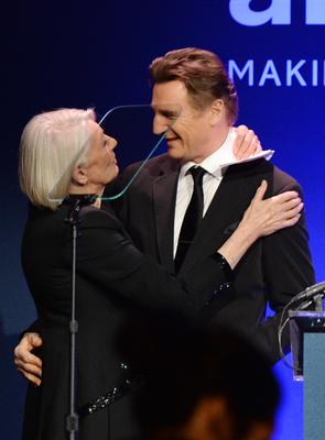 Vanessa Redgrave and Liam Neeson speak onstage during the 2014 amfAR New York Gala at Cipriani Wall Street on February 5, 2014 in New York City.  (Photo by Larry Busacca/Getty Images)