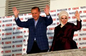 Turkey's Prime Minister Tayyip Erdogan and wife Ermine wave hands to supporters as they celebrate his election victory in front of the party headquarters in Ankara. Reuters