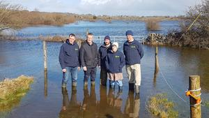 Connacht IFA chairman Pat Murphy; Tim Cullinan, IFA president; Joe Rock, Ann Mitchell, Galway IFA chair, and Martin Murphy, pictured on the Rock farm near Gort, which has been severely affected by recent flooding.