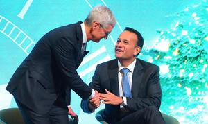 Public figures: Apple chief executive Tim Cook (left) is congratulated by then taoiseach Leo Varadkar as the tech boss was conferred with the IDA's Special Recognition Award in Dublin in January 2020. Photo: Frank McGrath