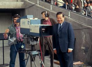 Michael O'Hehir beside an RTÉ camera in the entrance to the Hogan Stand, Croke Park, Dublin. Photo: Connolly Collection / Sportsfile