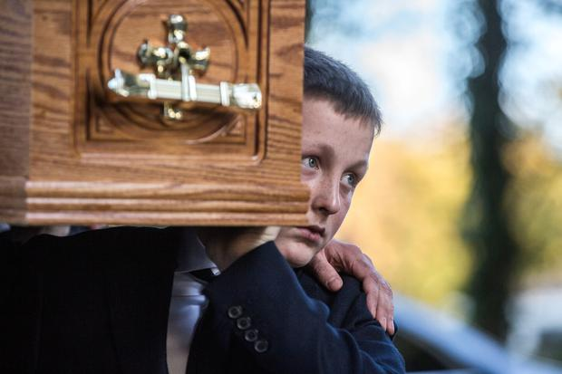 The coffin of broadcaster Gay Byrne is brought to St Fintan's Cemetery after his funeral mass. Pic:Mark Condren