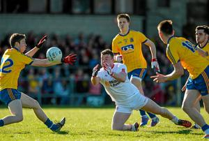 Daniel McNulty passes the ball as he is closed down by Roscommon's Onan Daly and Shane Killoran