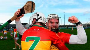 Carlow's Chris Nolan celebrates with teammate Kevin McDonald following their play-off victory over Offaly. Photo: Eóin Noonan/Sportsfile