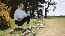 Rock star: Amy Kinsella from Newbridge, Kildare, with her 'Tin Of Beans' and 'Be A Little Boulder' painted rocks. Amy started the 'Paint A Rock' campaign on the Curragh plains to create a positive experience for families. Photo: Michael Donnelly