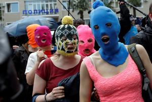 Five women wearing balaclavas, two of whom are members of the Russian punk group Pussy Riot, being released from a police station in Adler, Russia