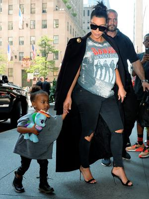 Kim Kardashian and North West are seen outside the Trump Hotel on September 7, 2015 in New York City.  (Photo by Raymond Hall/GC Images)