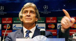Manchester City's coach Manuel Pellegrini attends a news conference