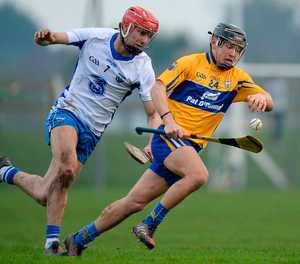 Clare's David Reidy in action against Seamus Keating of Waterford. Photo: Seb Daly/Sportsfile