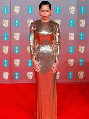 US actress and singer Zoe Kravitz poses on the red carpet upon arrival at the BAFTA British Academy Film Awards at the Royal Albert Hall in London on February 2, 2020. (Photo by Tolga AKMEN / AFP)