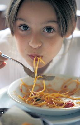 A big bowl of pasta with lashings of Bolognese sauce is full of refined carbs and salt. Picture posed