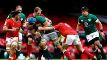 Tadhg Beirne of Ireland is tackled by Alun Wyn Jones and Ken Owens of Wales