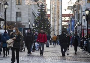 Shoppers wearing masks close to the Spire on Talbot Street in Dublin yesterday afternoon