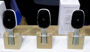 Hair Coach smart hairbrushes are displayed at the Withings booth during CES Unveiled before CES International, Tuesday, Jan. 3, 2017, in Las Vegas. The brush uses sensors to track hair damage and will, via a smart-phone app, offer recommendations and advice on hair care. (AP Photo/John Locher)