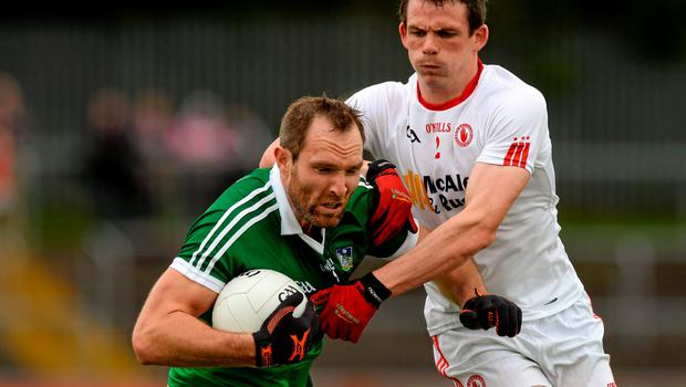 28 June 2015; Tom Lee, Limerick, in action against Aidan McCrory, Tyrone. GAA Football All-Ireland Senior Championship, Round 1B, Tyrone v Limerick. Healy Park, Omagh, Co. Tyrone. Picture credit: Oliver McVeigh / SPORTSFILE