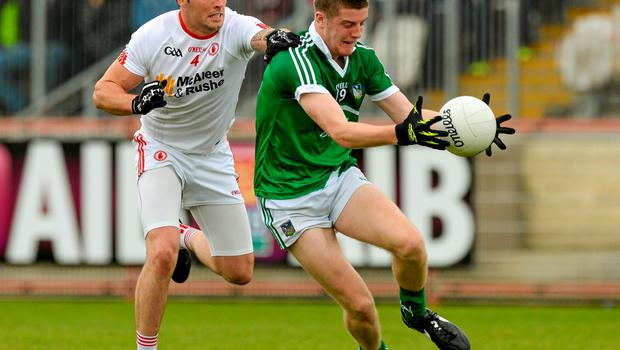 28 June 2015; Brian Fanning, Limerick, in action against Cathal McCarron, Tyrone. GAA Football All-Ireland Senior Championship, Round 1B, Tyrone v Limerick. Healy Park, Omagh, Co. Tyrone. Picture credit: Oliver McVeigh / SPORTSFILE