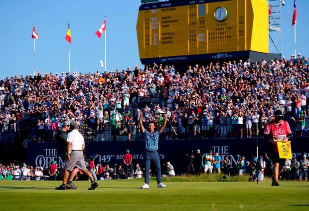 USA's Collin Morikawa celebrates his final putt to win The Open at The Royal St George's Golf Club in Sandwich, Kent.