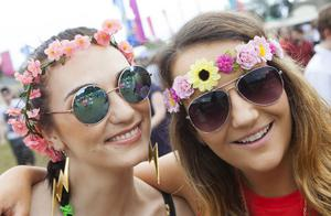Revelers enjoy day 2 of Longitude 2014 in Marley Park. Pictured: Laura Graham and Aoife Byrne. Photo: Tony Kinlan