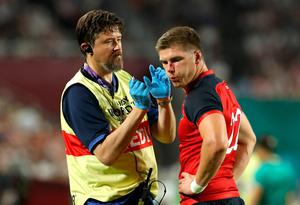 Owen Farrell of England receives medical treatment during the Rugby World Cup 2019 Group C game between England and USA at Kobe Misaki Stadium on September 26, 2019 in Kobe, Hyogo, Japan. (Photo by David Rogers/Getty Images)