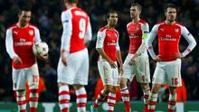 Arsenal's players react after Anderlecht's equalising goal during their Champions League soccer match at the Emirates stadium