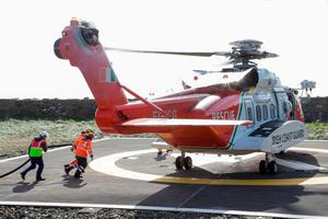 A Coast Guard Helicopter is refulled at Blacksod Lighthouse today. PIC COLIN O'RIORDAN