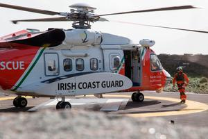 A Coast Guard Pilot pictured with a Helicopter at Blacksod Lighthouse today. PIC COLIN O'RIORDAN