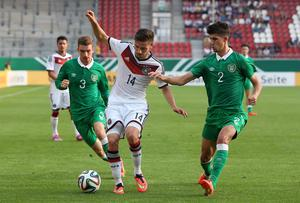 Jack Connors, left, and Shane Griffin, right, close down Germany's Julian Korb. Photo credit: Ronny Hartmann/Bongarts/Getty Images