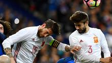 Sergio Ramos and Gerard Pique lined up alongside each other in white for Spain. Getty