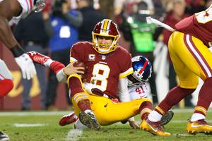 Washington Redskins quarterback Kirk Cousins (8) is sacked by New York Giants cornerback Dominique Rodgers-Cromartie (41) in the second quarter at FedEx Field. Credit: Geoff Burke-USA TODAY Sports