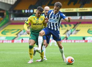 Norwich City's Max Aarons in action with Brighton & Hove Albion's Leandro Trossard. Photo: Joe Giddens/Pool via Reuters