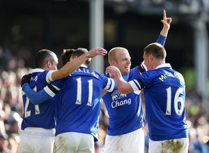 Everton's Steven Naismith (second right) celebrates after scoring his team's second goal during the FA Cup, Fifth Round match at Goodison Park.