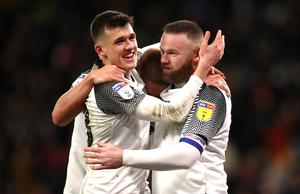 (l-r) Derby County's Jason Knight celebrates a goal with team-mate Wayne Rooney