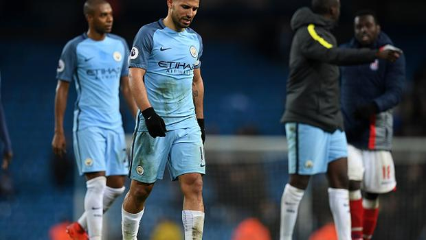 Manchester City's Argentinian striker Sergio Aguero (2nd L) reacts on the pitch after the English Premier League football match between Manchester City and Stoke City at the Etihad Stadium in Manchester, north west England, on March 8, 2017. The game finished 0-0. PAUL ELLIS/AFP/Getty Images