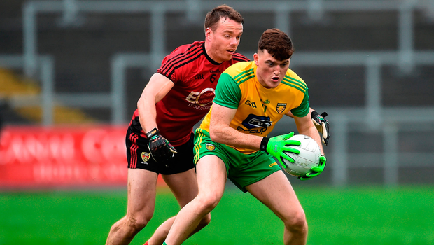 Niall O'Donnell of Donegal in action against Brendan McArdle of Down. Photo by Oliver McVeigh/Sportsfile