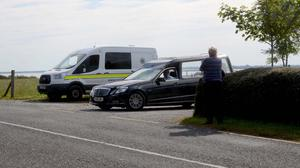 The body of a young boy who was recovered from Lough Mask is removed in a hearse this morning Pic Paul Mealey