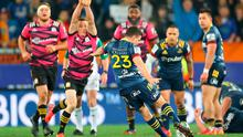 Highlanders Bryn Gatland kicks a drop goal to beat the Chiefs at Forsyth Barr Stadium in Dunedin. MARTY MELVILLE/AFP via Getty Images