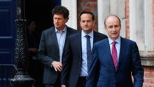 Minister for Climate Action, Communication Networks and Transport Eamon Ryan, Tanaiste Leo Varadkar and Taoiseach Micheal Martin. Photo: Julian Behal