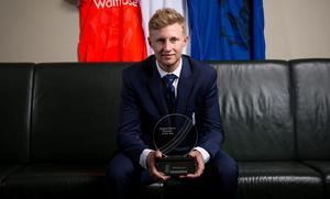 England's Joe Root poses with his trophy after being announced the ECB Mens Player of the Year