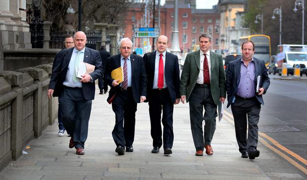Negotiations: The rural Independent deputies, from left, Noel Grealish, Mattie McGrath, Denis Naughten, Dr Michael Harty and Michael Collins arriving at Government Buildings for talks with the acting Taoiseach Enda Kenny TD and Fine Gael negotiators on the formation of a new government. Photo: Tom Burke