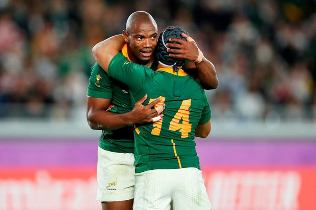 YOKOHAMA, JAPAN - NOVEMBER 02: Makazole Mapimpi of South Africa celebrates with teammate Cheslin Kolbe after scoring his team's first try during the Rugby World Cup 2019 Final between England and South Africa at International Stadium Yokohama on November 02, 2019 in Yokohama, Kanagawa, Japan. (Photo by Dan Mullan/Getty Images)