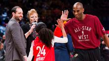 Kobe Bryant high-fives his daughter Gianna on the court in warm-ups before first half NBA All-Star Game basketball action in Toronto back in February 2016  (Mark Blinch/The Canadian Press via AP)