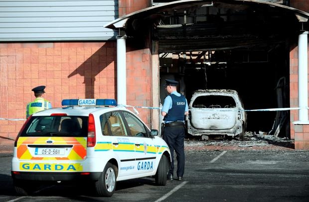 Gardai at scene of burnt-out car at entrance of Flyefit gym. Coolock retail park, Malahide Road, Dublin. Picture: Caroline Quinn