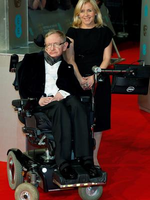 Theoretical physicist Stephen Hawking and his daughter Lucy arrive at the British Academy of Film and Arts (BAFTA) awards ceremony at the Royal Opera House in London February 8, 2015. REUTERS/Suzanne Plunkett