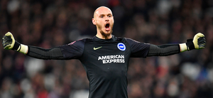 Brighton's David Button celebrates after teammate Dale Stephens scores his team's first goal. Photo: Getty Images