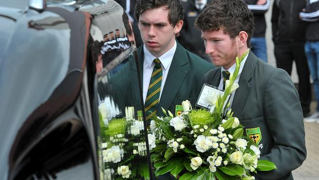 Schoolfriends of Ronan Hughes attend his funeral at St Patrick's Church in Clonoe, Co Tyrone. Photo: Justin Kernoghan
